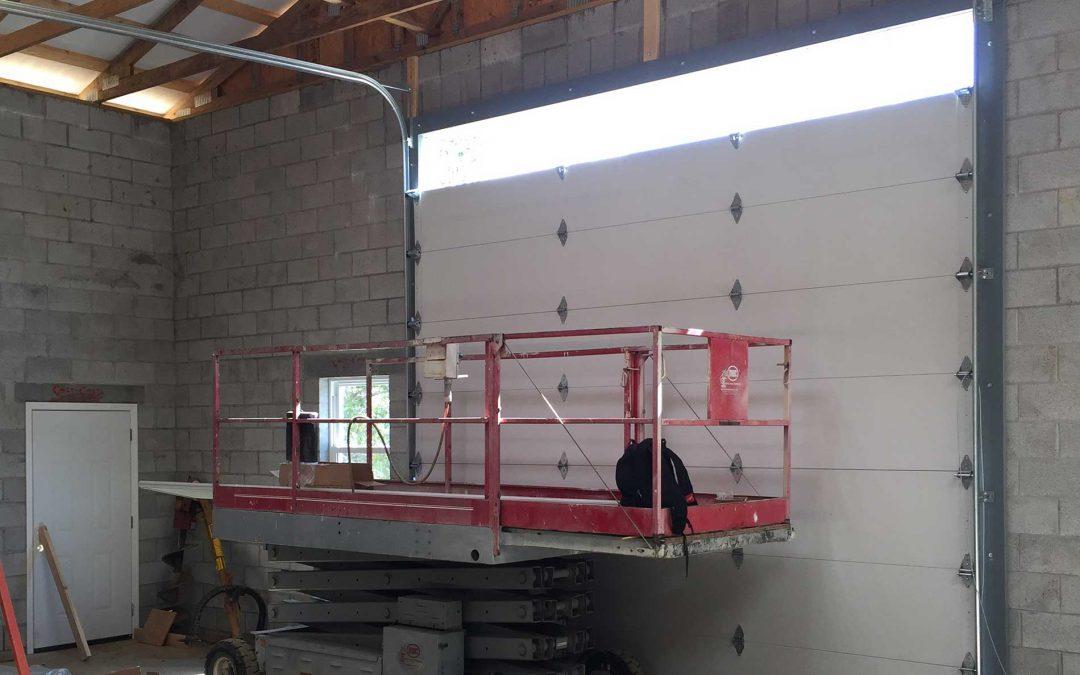 Garage Door Repair: Fixing or replacing garage door track